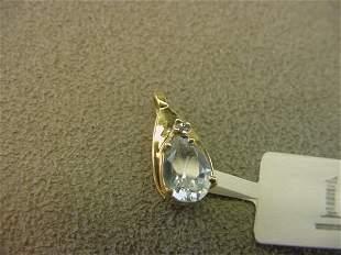 10K GOLD AQUAMARINE AND DIAMOND PENDANT