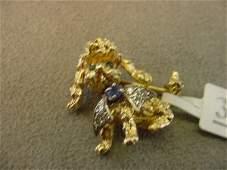 1393: 14K GOLD DIAMOND, SAPH AND EMERALD DOG PIN