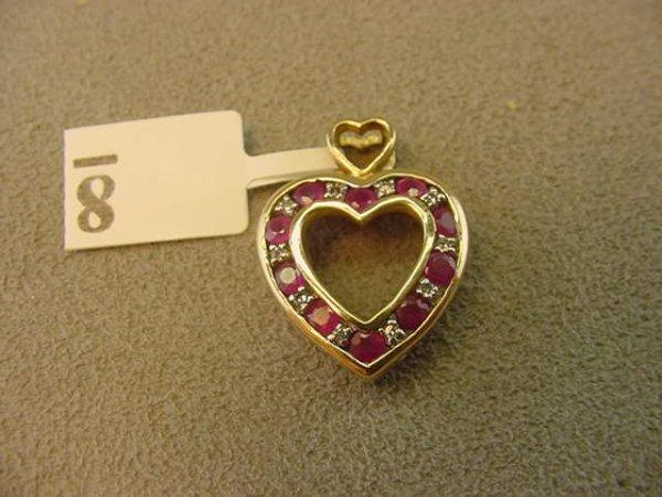 3008: 10K GOLD RUBY AND DIAMOND HEART PENDANT