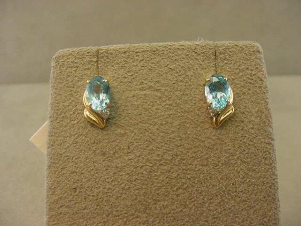 3015: 14K GOLD BLUE TOPAZ EARRINGS
