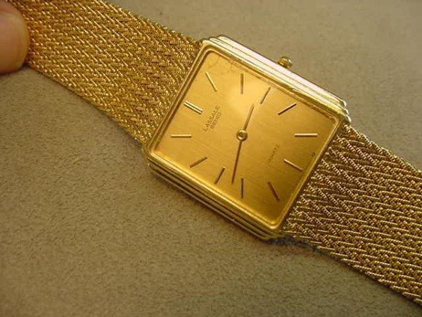 3021: MAN'S LASALLE QUARTZ 14K GOLD WRISTWATCH
