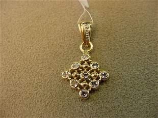10K GOLD TANZANITE AND DIAMOND PENDANT