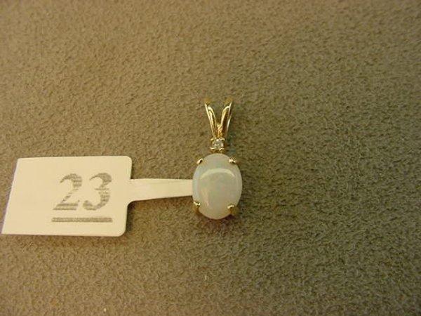 1023: 14K GOLD OPAL AND DIAMOND PENDANT