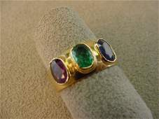 1309 18K GOLD BLUE SAPPHIRE RUBY AND EMERALD RING