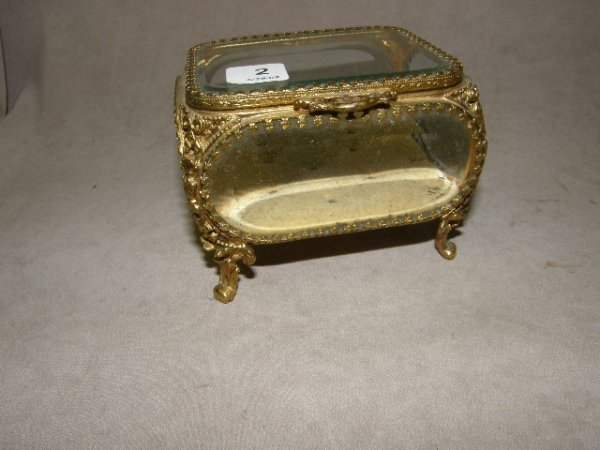 2002: GILT METAL AND BEVELED GLASS JEWELRY BOX