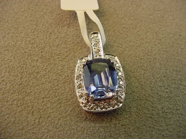 3003: 10K WHITE GOLD BLUE STONE AND DIAMOND PENDANT