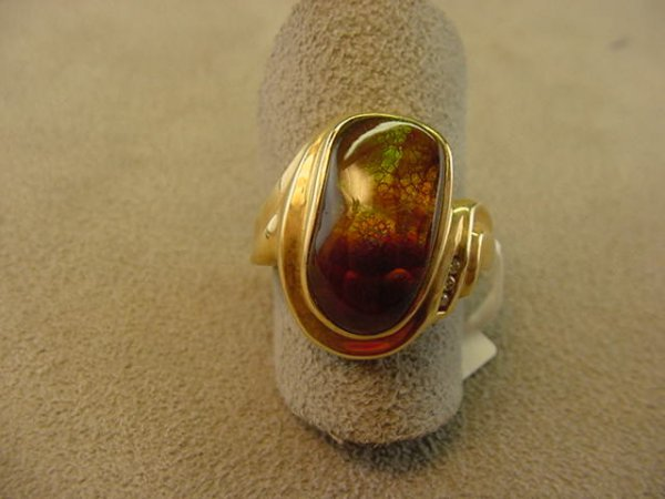 5182: 1 14K GOLD RING SET WITH 1 FIRE AGATE SIZE 7 1/2