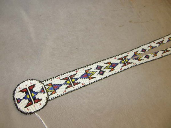 6024: INDIAN BEADED ITEM WITH FEATHER TRIM
