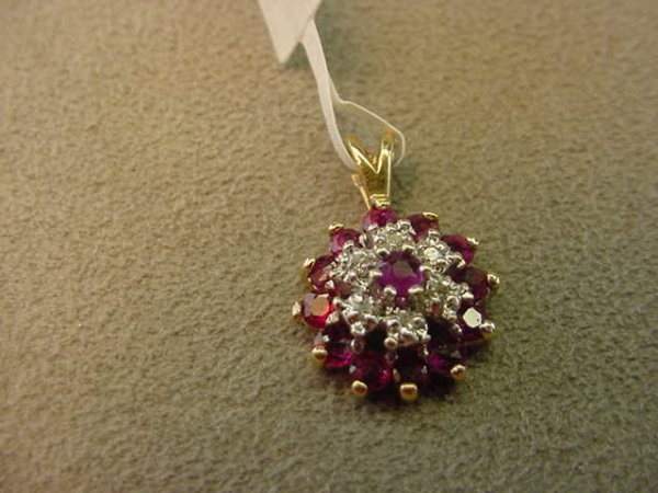 8007: 10K GOLD RUBY AND DIAMOND PENDANT