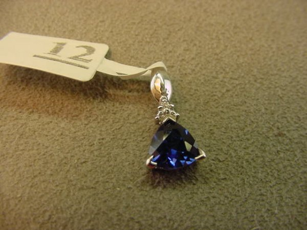 8012: 10K WHITE GOLD BLUE STONE AND DIAMOND PENDANT