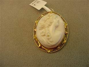 CARVED SHELL CAMEO IN 10K GOLD MOUNT