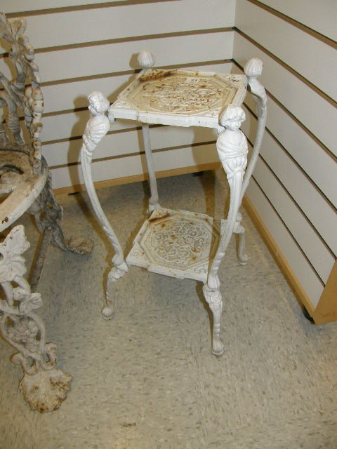 1021: CAST IRON PAINTED STAND