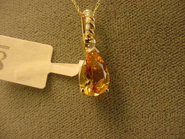 2008: 10K GOLD CITRINE AND DIAMOND PENDANT