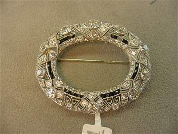 2141: ANTIQUE PLATINUM DIAMOND FILIGREE BROOCH