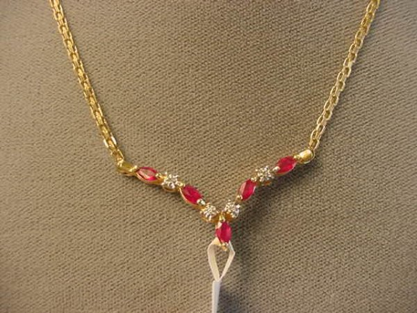 5001: 10K GOLD RUBY AND DIAMOND NECKLACE