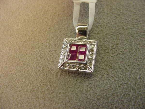 5019: 14K WHITE GOLD RUBY AND DIAMOND PENDANT