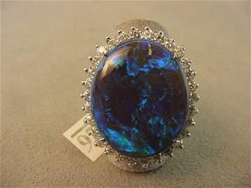 5026: 14K WHITE GOLD BLACK OPAL AND DIAMOND RING