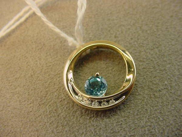 7604: 10K GOLD BLUE TOPAZ AND DIAMOND PENDANT