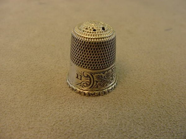 7610: 1 ANTIQUE STERLING THIMBLE--SOME HOLES ON TOP