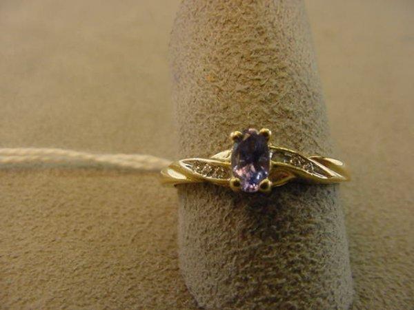 7618: 14K GOLD TANZANITE AND DIAMOND RING