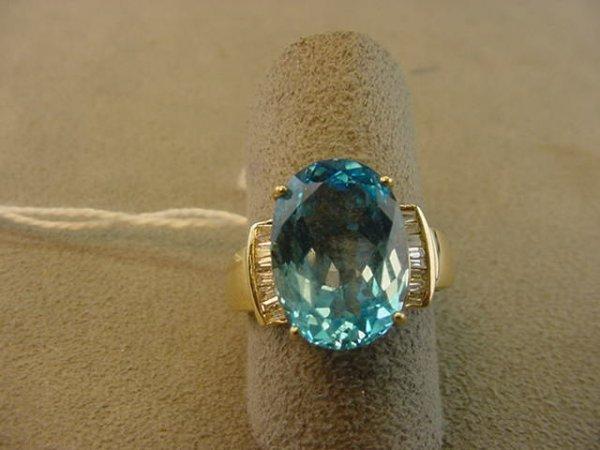 7622: 14K GOLD BLUE TOPAZ AND DIAMOND RING