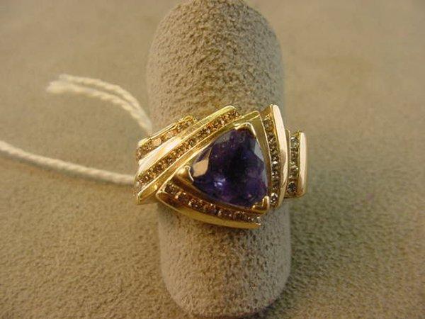 7869: 14K GOLD TANZANITE AND DIAMOND RING