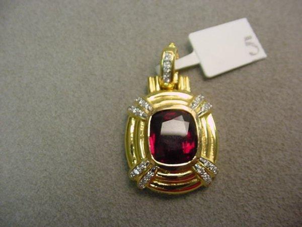 1005: 14K HINGED RHODOLITE GARNET AND DIAMOND PENDANT