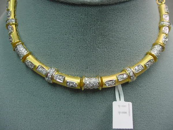 1011: 22K GOLD AND CUBIC ZIRCONIA NECKLACE