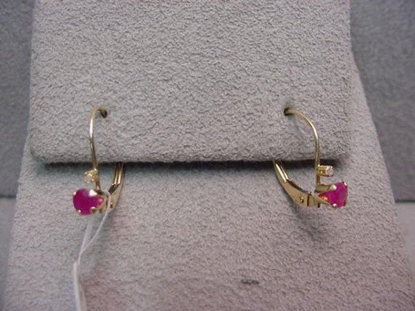 1019: PAIR 10K RUBY AND DIAMOND EARRINGS