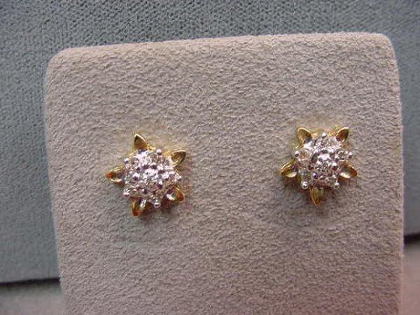 1021: PAIR 10K DIAMOND EARRINGS