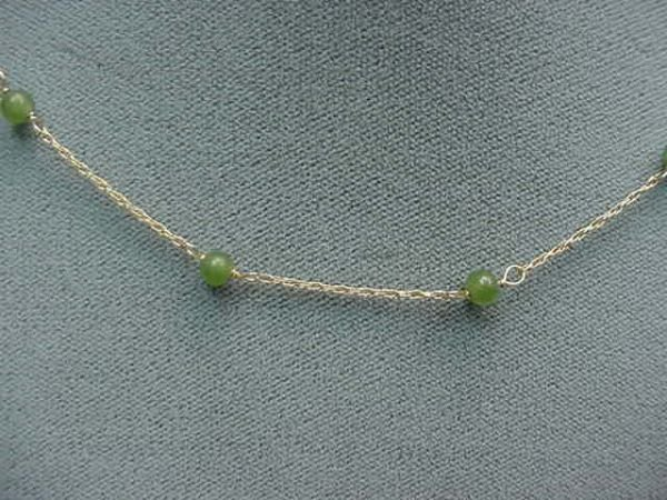 """2146: 16"""" 14K GOLD CHAIN WITH JADE SPACERS"""