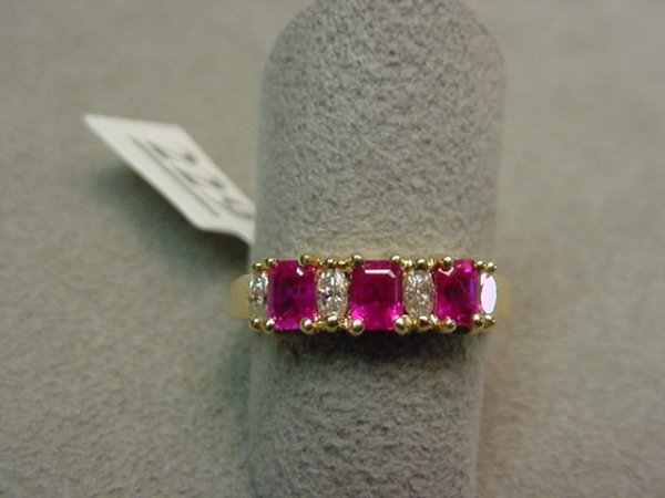 3229: 14K RUBY AND DIAMOND RING