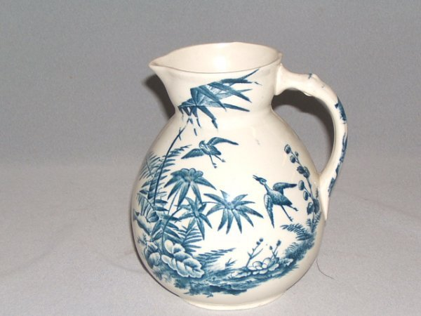 4062: 2 D.B.&CO. 'INDIAN' PATTERN PITCHERS