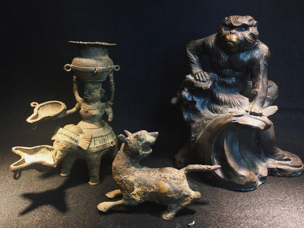 Three bronze carvings.
