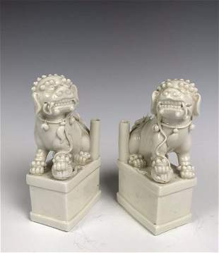 Two Chinese White Glazed Lions