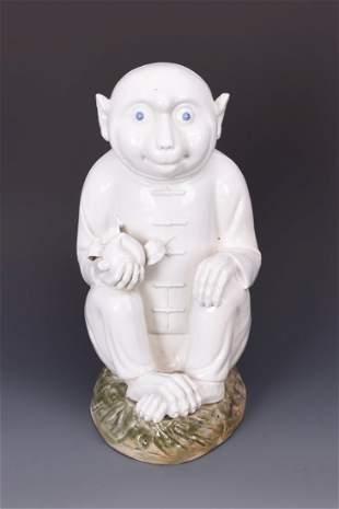 Porcelain Monkey Holding an Apple