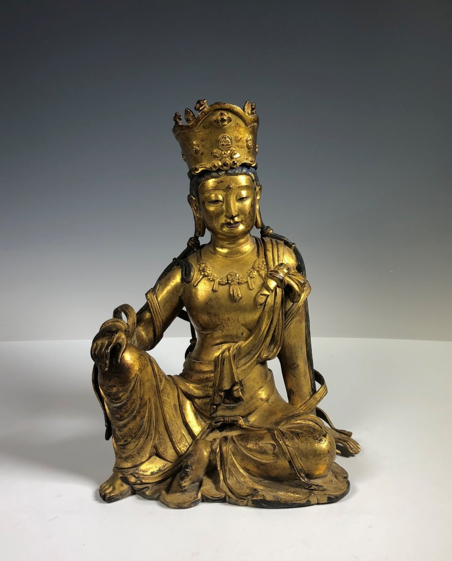 A Large Gilt Bronze Figure of Seated GuanYin