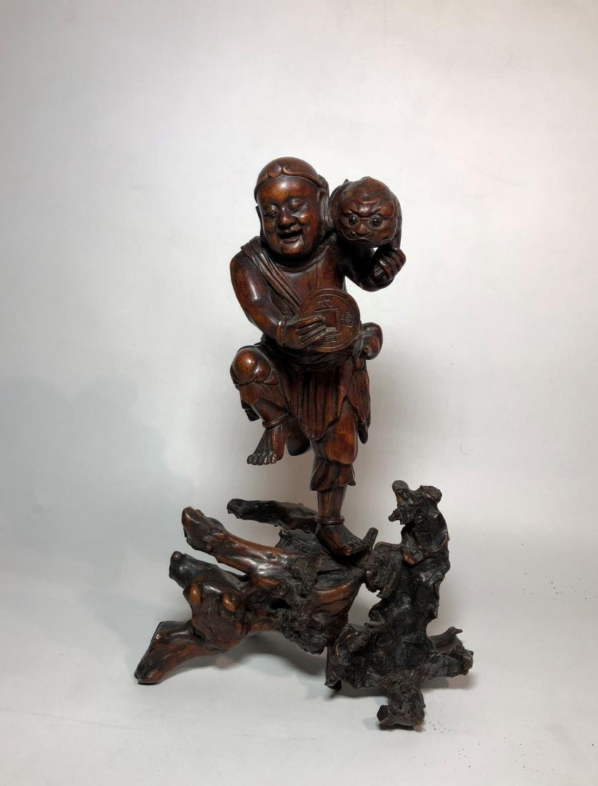 Carved Boxwood Figure of Man Holding Coin and Animal