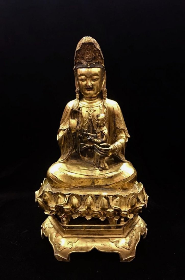 A Large Gilt Bronze Figure Of Guan & Child