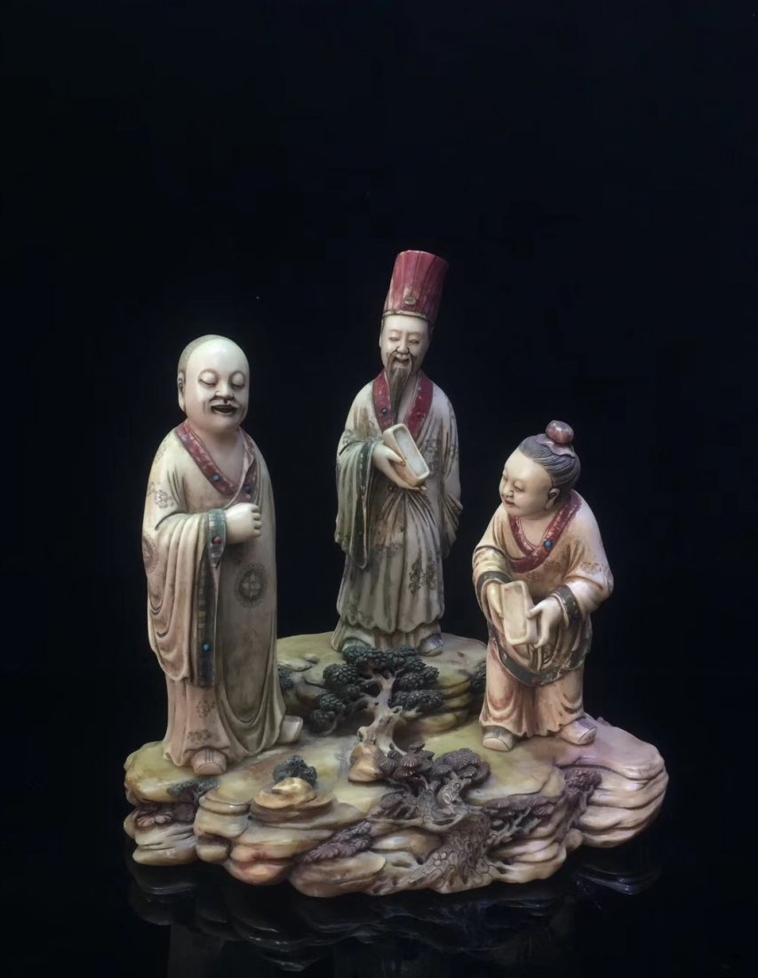 A Carved Soapstone Figures