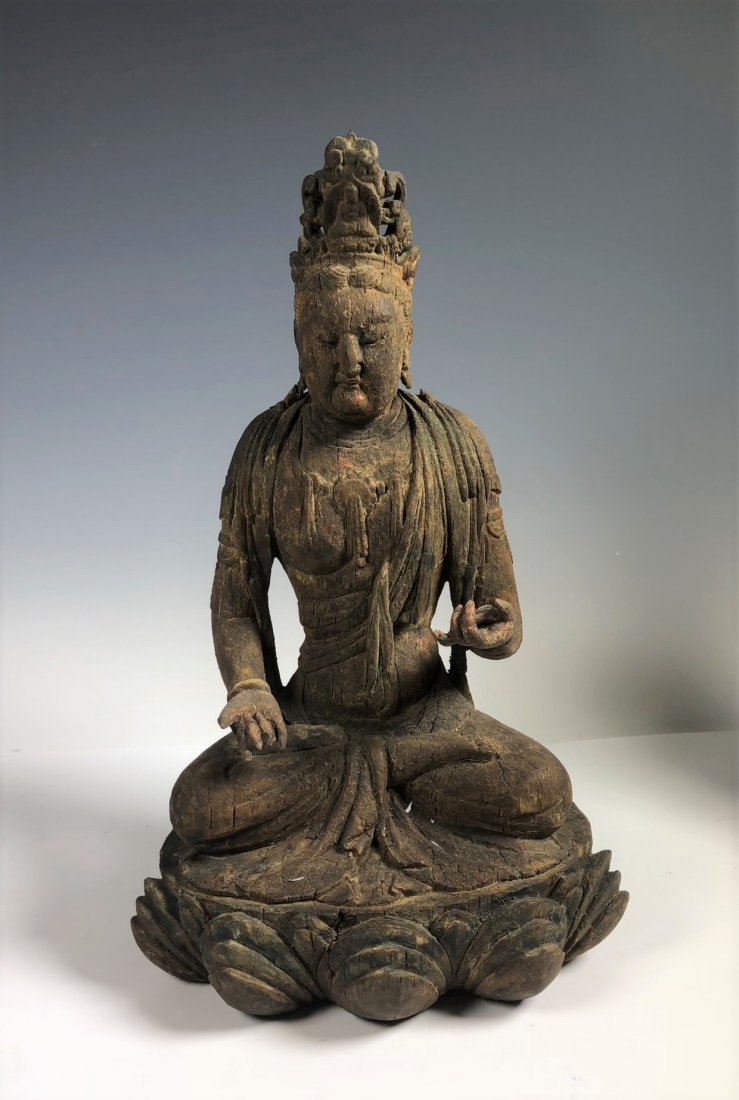 A Carved wood Figure Of Buddha