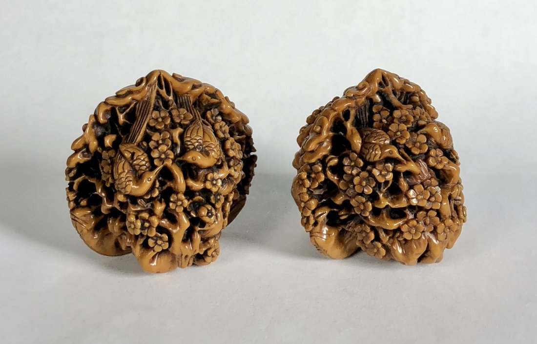 A Pair Of Carved Walnut