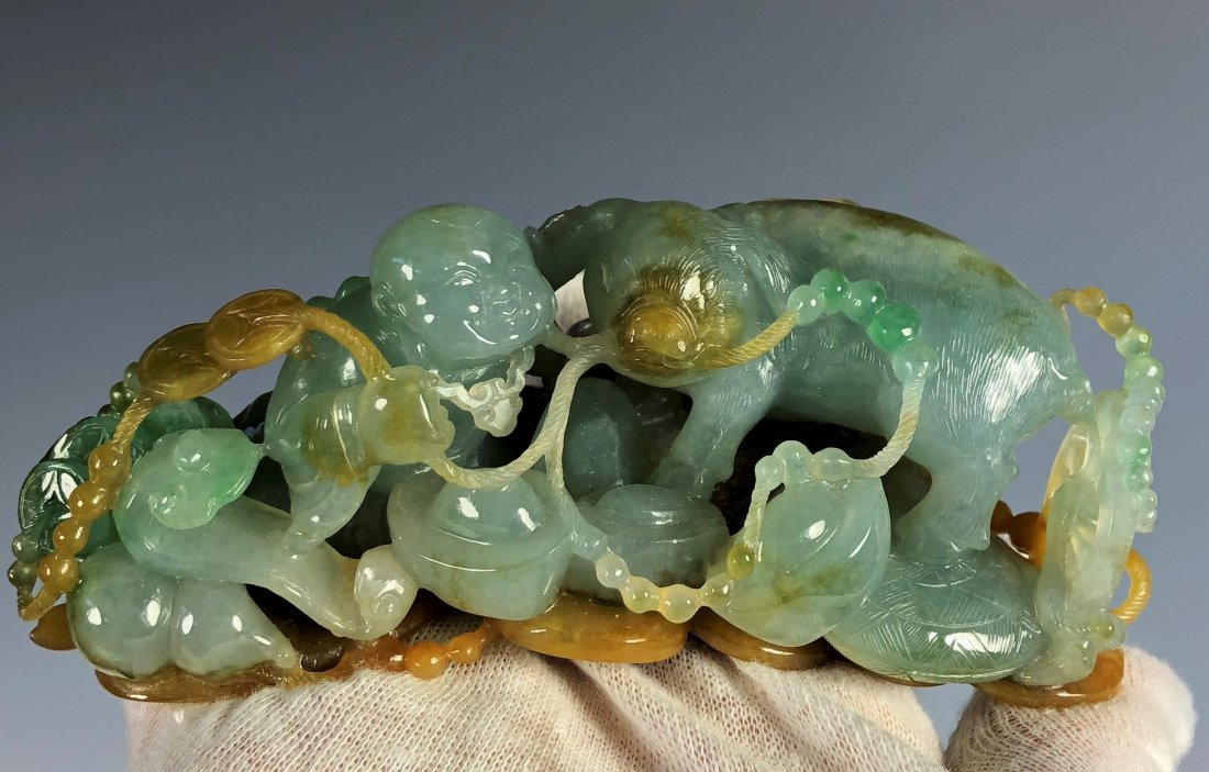 A Carved Natural Three Colore  Jadeite Figure Of...
