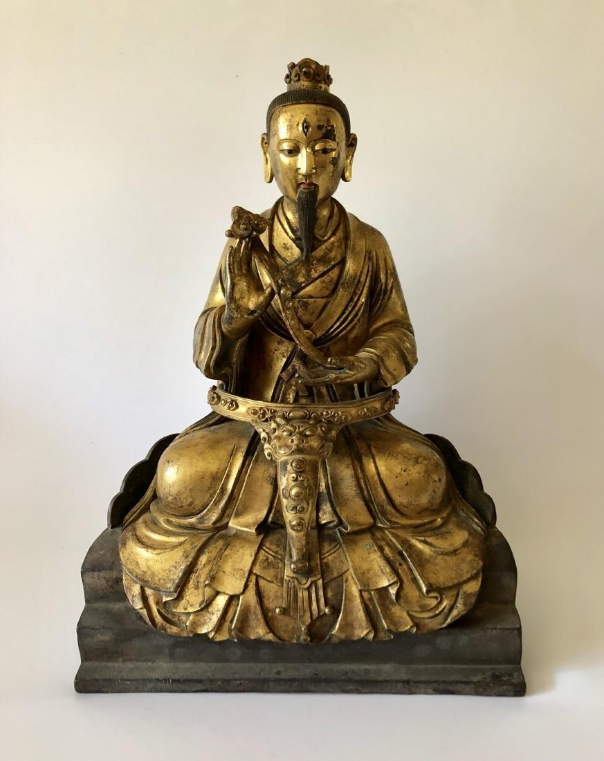 A Rare Gilt Bronze Taoist Figure Holding A Ruyi