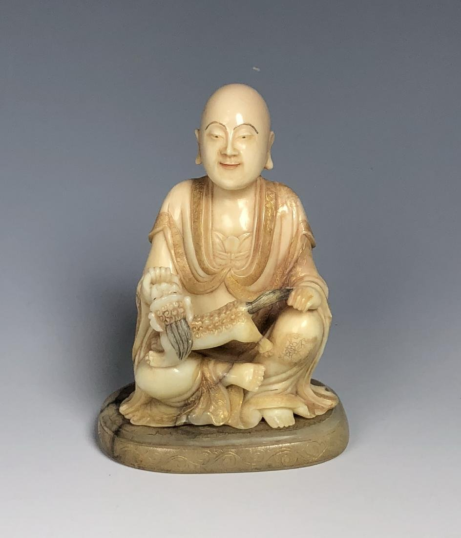 Carved Soap Stone Figure Holding Animal