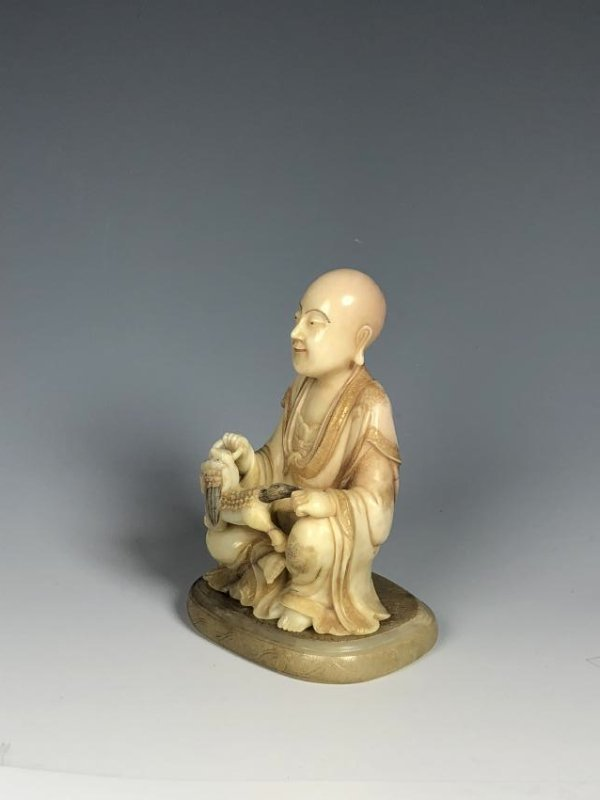 Carved Soap Stone Figure Holding Animal - 2