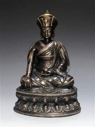 A Rare SilverInlaid Copper Alloy Figure of Guru