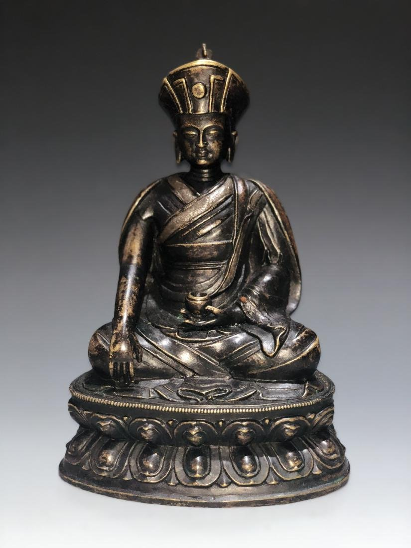 A Rare Silver-Inlaid Copper Alloy Figure of Guru