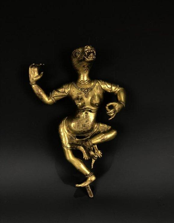 Gilt bronze figure with animal head