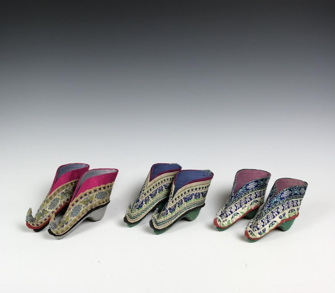 Three Pairs of Silk Boots